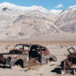 Rusted cars in a desert